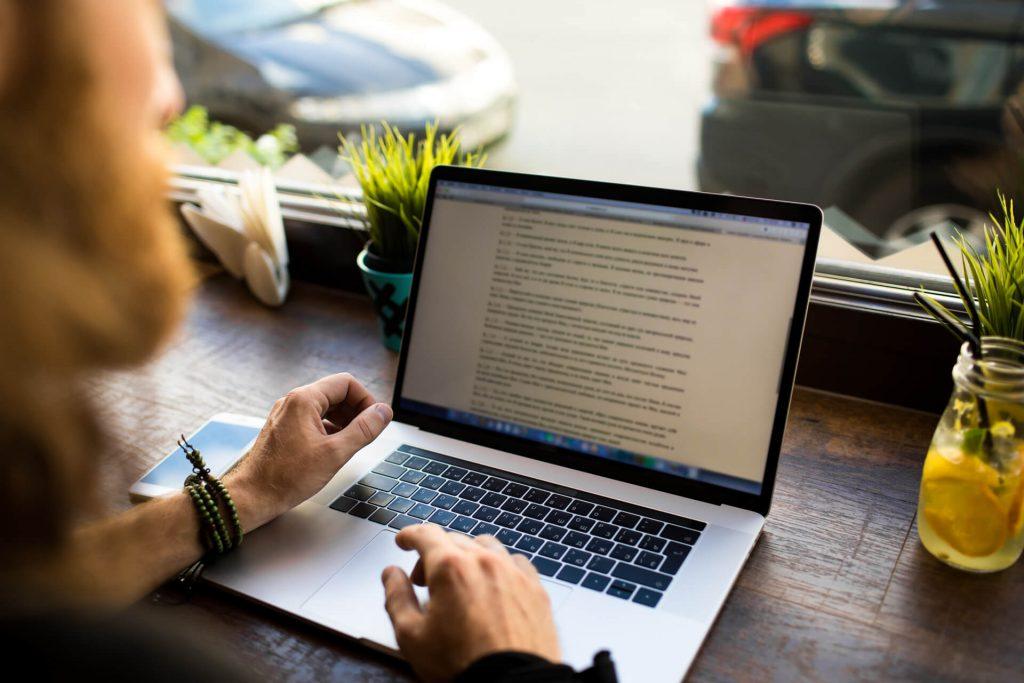 Woman Reviewing Blog Man Wrote