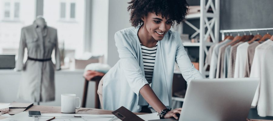 Black Woman Business Owner At Computer Using Digital Marketing In Dallas